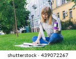 an adult girl is reading on the ... | Shutterstock . vector #439072267