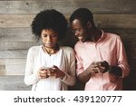 african couple using gadgets ... | Shutterstock . vector #439120777
