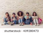 group of teenage boys and girls