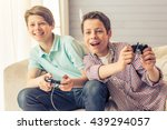 two attractive teenage boys are ... | Shutterstock . vector #439294057