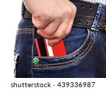Small photo of Person take up Credit Card from the Pocket of the Jeans