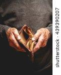 empty wallet in the hands of an ... | Shutterstock . vector #439390207