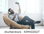time to relax. handsome young... | Shutterstock . vector #439432027