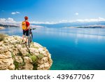 mountain biker looking at view... | Shutterstock . vector #439677067