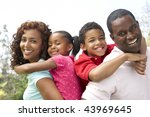 portrait of happy family in park | Shutterstock . vector #43969645
