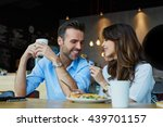 happy couple at restaurant... | Shutterstock . vector #439701157