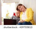 happy mother and son looking at ... | Shutterstock . vector #439705813
