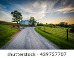 Dirt Road And Farm At Sunset ...