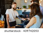 couple making payment with... | Shutterstock . vector #439742053