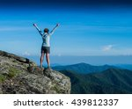 power posing on a rock in the... | Shutterstock . vector #439812337