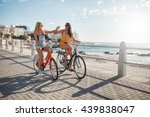 two female friends riding... | Shutterstock . vector #439838047