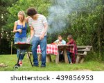group of friends on a barbecue... | Shutterstock . vector #439856953