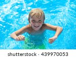 Smiling Little Boy Has Fun In...