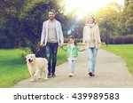 Stock photo family pet domestic animal and people concept happy family with labrador retriever dog walking 439989583