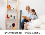 mother and daughter reading... | Shutterstock . vector #440132557