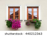 Two Windows With Brown Wooden...