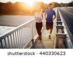 active couple jogging outdoors... | Shutterstock . vector #440330623