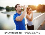 couple staying hydrated after...   Shutterstock . vector #440332747