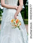 beautiful bride is holding a... | Shutterstock . vector #440354377