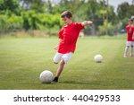 little boy shooting at goal | Shutterstock . vector #440429533