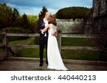 Groom Holds Bride Tenderly In...