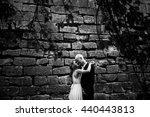 Bride Hugs Groom Tenderly...