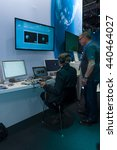 Small photo of BERLIN, GERMANY - JUNE 01, 2016: The stand of German Aerospace Center (DLR). The simulator remote control technology. Exhibition ILA Berlin Air Show 2016.