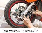 mechanic fixing motocycle  worn ... | Shutterstock . vector #440506927