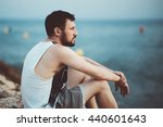 a man sitting on a stone and... | Shutterstock . vector #440601643