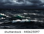 breaking waves at rising storm | Shutterstock . vector #440625097