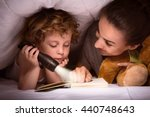 mother and son reading book... | Shutterstock . vector #440748643