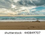 wave spray splash over beach at ... | Shutterstock . vector #440849707