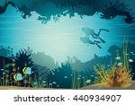 Two Scuba Divers Swimming Near...