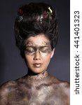 Small photo of Female model in Airbrush make up like body paint, lace style in black background, shadow technique