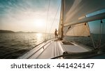 young man standing on the yacht ... | Shutterstock . vector #441424147