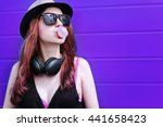 hipster girl with headphones at ... | Shutterstock . vector #441658423