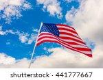 american flag on blue sky | Shutterstock . vector #441777667