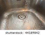 Kitchen Sink With Water Runnin...