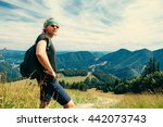 young man traveler in mountain | Shutterstock . vector #442073743