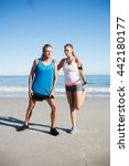 couple stretching at the beach...   Shutterstock . vector #442180177