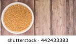 yellow mustard seed in white... | Shutterstock . vector #442433383