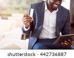 Successful Man Holding Bank Card
