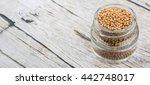 yellow mustard seed in mason... | Shutterstock . vector #442748017