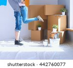 happy young couple moving in... | Shutterstock . vector #442760077