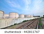 big white gasoline and oil