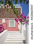 Small photo of Classical Greek architecture of the streets with white stairs, Santorini Island in Greece.