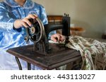Woman Sewing On Antique Machine