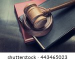 gavel and legal books on wooden