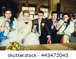 newlyweds and friends drink... | Shutterstock . vector #443472043