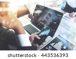 Business team meeting. Photo professional investor working new start up project. Finance task.Digital tablet laptop computer smart phone using, Sun flare effect